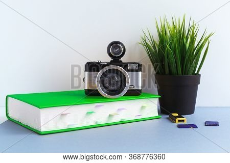 The Concept Of Studying Photography, Camera And Texbook