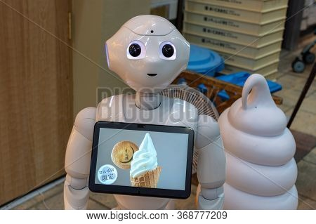 Osaka / Japan - October 6, 2017: Cute Humanoid Robot At Ice Cream Shop In Osaka, Japan