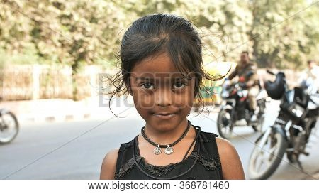 Agra, India - December 12, 2018: Portrait Of A Cute Young Indian Girl On The Streets Of Agra.