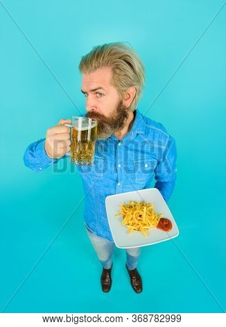 Man With Fastfood. French Fries In Restaurant. Bearded Guy With Snack. Fast Food, Unhealthy Eating,