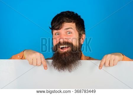 Advertising Banner. Ready For Your Text. Smiling Man With Blank Board. Handsome Man Shows Empty Boar