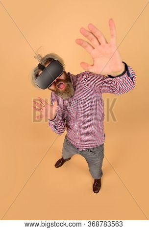 Scared Man In Virtual Reality Headset. Future. Future Technology Concept. Men Using Vr Headset. Virt