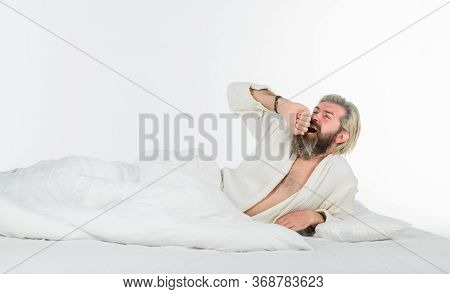 Sleepy Yawning Man. Tired Sleepy Man In Bathrobe. Morning Routine. Man In Bedroom. Morning And Wake