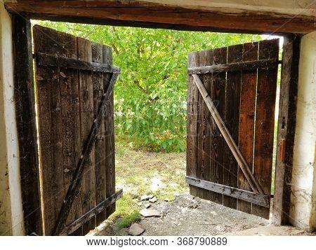 Beautiful Old Wooden Open Door. Inside View Of The Room. Crib Doors, Stall For Livestock Or Garage.