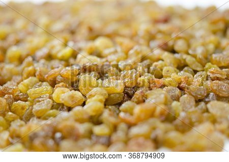 Raisins Close Up. Dry Grapes. Dried Fruits For Healthy Food, Dessert Substitute
