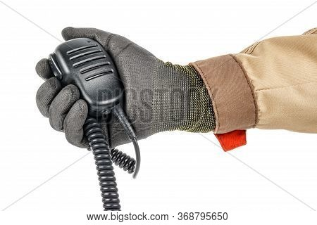 Walkie Talkie Handheld Microphone With Spiral Connection Cord In Male Hand In Black Protective Glove
