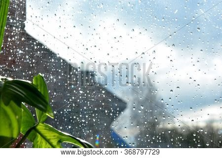 Blurred Gray And Blue Background. Raindrops On The Transparent Window Pane. Background Of Raindrops