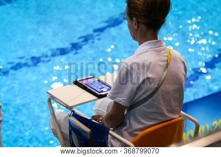 Kyiv, Ukraine - August 9, 2019: Diving Referee Rates A Dive During The Mixed 10m Synchro Final Of Th
