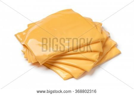 Heap of slices cheddar cheese close up isolated on white background