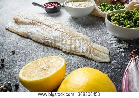 Cod Fish For English Traditional Fish And Chips Ingredients Beer Batter, Potatoe, Tartar Sauce, Mint