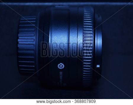 Delhi - India 30th May 2020 Side Angle View Of Dslr Prime Lens 35mm In Blue Background. A Prime Lens