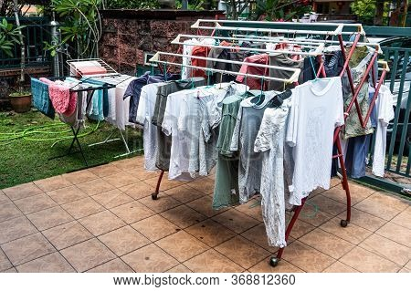 Laundry Fabric Being Dried Under Bright Hot Sun In Home Compound After Wash In Malaysia