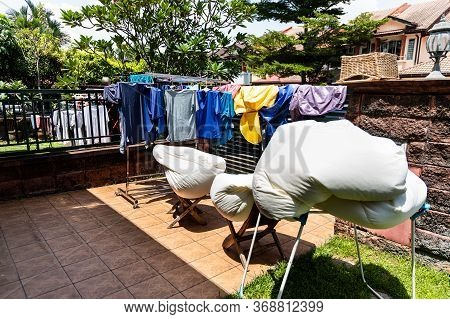Laundry Fabric Being Dried Under Bright Hot Sun In Home Compound After Wash