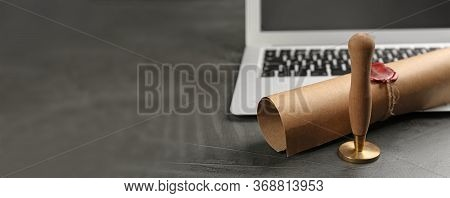 Notary's Public Pen And Sealed Document Near Laptop On Grey Stone Table, Space For Text. Banner Desi