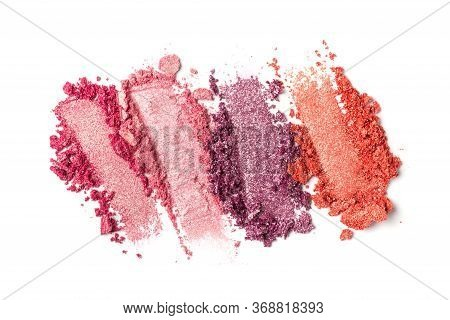 Close-up Of Make-up Swatches. Smears Of Crushed Shiny Pink, Red And Purple Eye Shadow