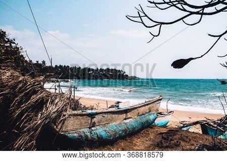 Abandoned Old Fishing Boat On The Beach. Deserted Landscape On An Isolated Island. Forgotten And Lon
