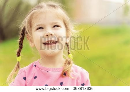 Portrait Of A 4 Year Old Girl On An Open Air