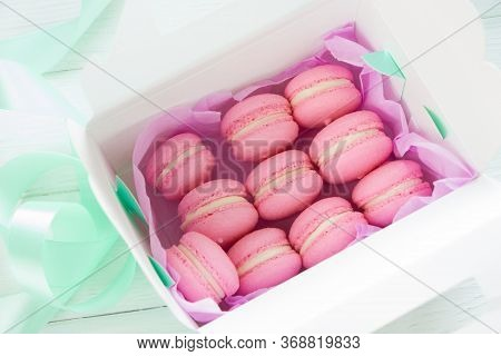 Sweet Pink  French Macaroons Or Macaron On  Gift Box . Creative Layout  On Wooden Board. Macaroons B