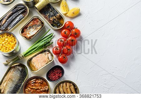 Assortment Of Canned Preserves Food In Tin Open Cans. With Fresh Organic Ingridients Saury, Mackerel
