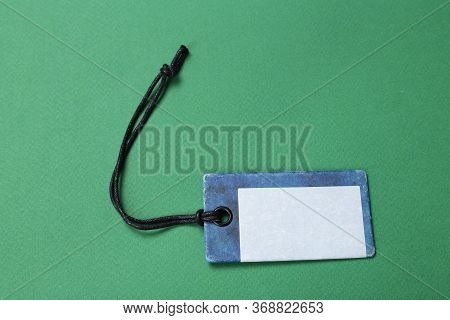Blank Tag Tied With String. Price Tag, Gift Tag, Sale Tag, Address Label Isolated On Green Backgroun