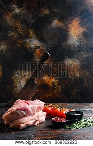 Pair Organic Raw Pork Chops Arranged For Cooking Over Wooden Table And Rustic Backdrop And Chopping