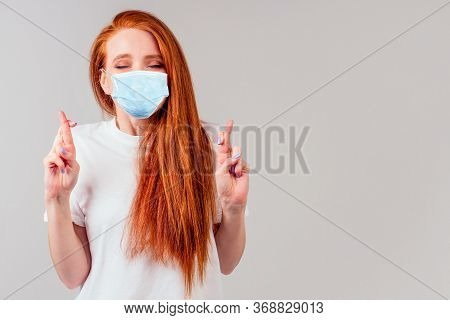 Fingers Crossed Wishing The Best In Studio Gray Background Redhair Ginger Woman Feeling Unhappy And