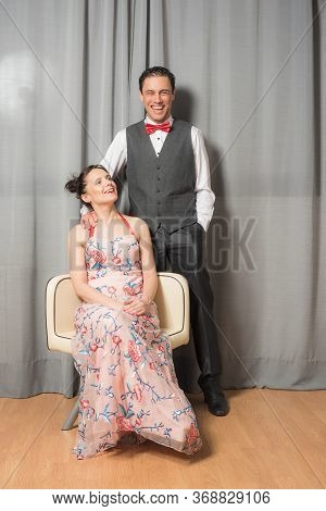 Portrait Of Smiling Upper Class Marriage