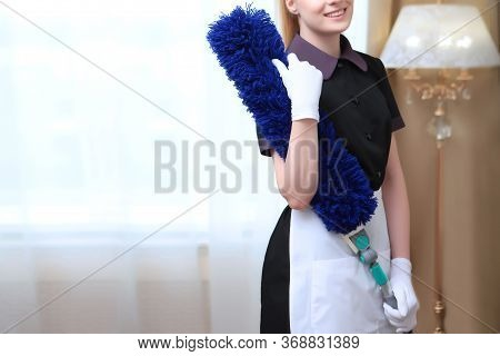 Maid In Uniform And White Gloves, Holding In His Hand The Large Brush To Remove Dust. Unrecognizable