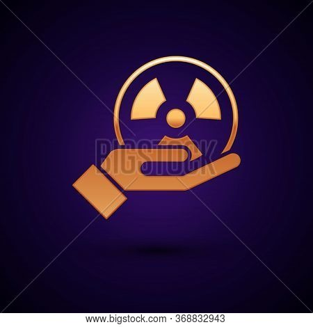 Gold Radioactive In Hand Icon Isolated On Black Background. Radioactive Toxic Symbol. Radiation Haza