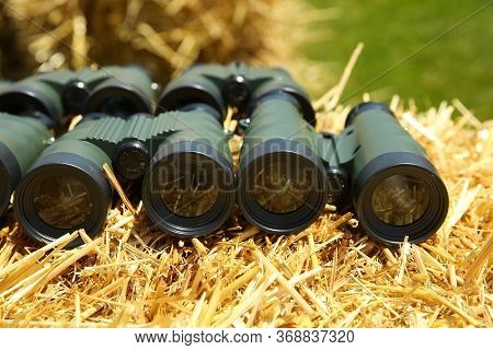 Binoculars On The Haystack. Binoculars Brown Grass Leather Outdoors