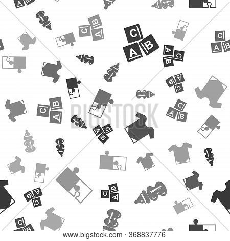 Set Abc Blocks, Baby Bottle, Baby Onesie And Piece Of Puzzle On Seamless Pattern. Vector.