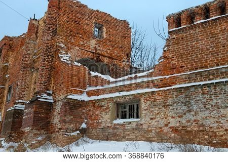 Empty Window Openings In An Abandoned Ruined Red Brick Building