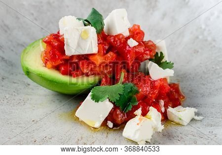 Raw Salmon Tartare, Trout Tartar Or Red Fish Cubes Salad With Fresh Avocado Closeup. Macro Shot Of D