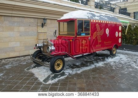 Kazan, Russia - January 5 2020: New Year's Design Of City. Red Retro Car In Landscape Design On The