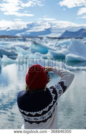 Exploring Beautiful Icelandic Nature. Young Girl, Female Tourist Or Photographer Taking A Photo Of F