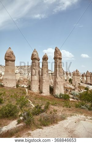 View Of The High Stone Pillars In Goreme. Amazing Rocks In Cappadocia, Turkey Eroded Into Spectacula