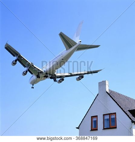 Schiphol Runway Approach By Plane Low Over Houses On Landing Approach For Amsterdam Schiphol Airpoer