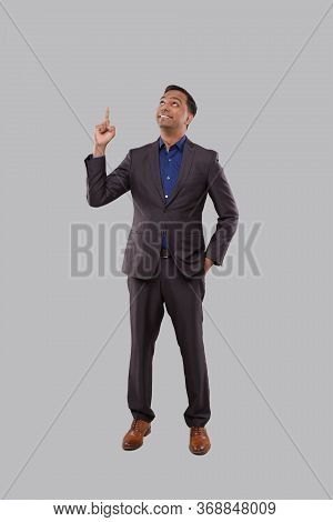 Businessman Poiting Up Isolated. Indian Man Standing Full Lenght