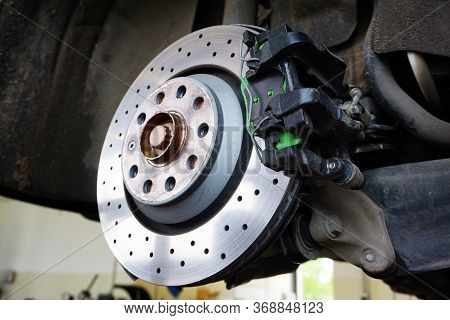 Modern Ventilated Perforated Brake Disc Mounted On A Car. Modern Technologies To Increase The Effici