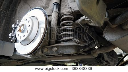 The Structure And Elements Of Suspension Of A Modern Car. Shock Absorber, Suspension Arm, Spring, Su