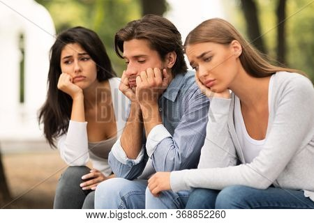 Boredom. Three Bored Friends Sitting Sad On Bench In Park Spending Time Together In Park Outdoors. S
