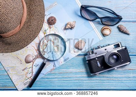 Top View Of Planning Vacation Planning Using A Map, Magnifier, Retro Camera - Travel Influencer Look