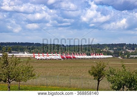 DUEBENDORF, SWITZERLAND - May 24: Swiss airlines planes grounded on the military airfield on May 24, 2020 in Duebendorf. Due to Coronavirus (COVID-19) outbreak airlines are canceling most of flights.