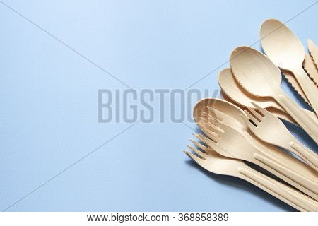 Eco-friendly Tableware. Spoons, Forks, Knives Made Of Wood. Tableware Is On The Right Side