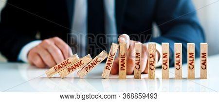 Panic Calm Concept. Hand Stops Falling Blocks With The Word Panic And Builds Blocks With The Word Ca