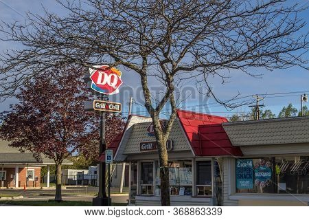 Mackinaw City, Michigan, Usa - May 30, 2020: Exterior Of Dairy Queen Restaurant, Store And Sign In M