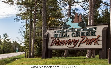 Mackinaw City, Michigan, Usa -  May 30, 2020: Entrance Sign To The Mill Creek Discovery Center. The