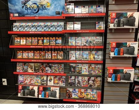 Honolulu - April 7, 2017: Nintendo Switch, Bayonetta 2, And Other Video Game Merchandise On Display