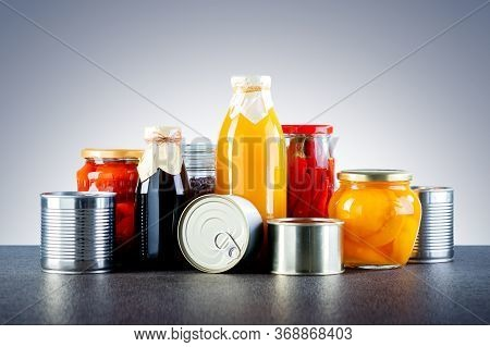 Different Types Of Canned Food. Different Glass Jars With Grains, Pasta, Vegetable, Cans Of Canned F