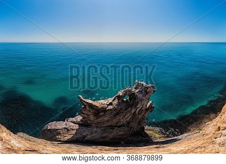 The Rock Or Lava Formation With The Shape Of A Large Animal Or Dragon Head Arise From The Water. Pop